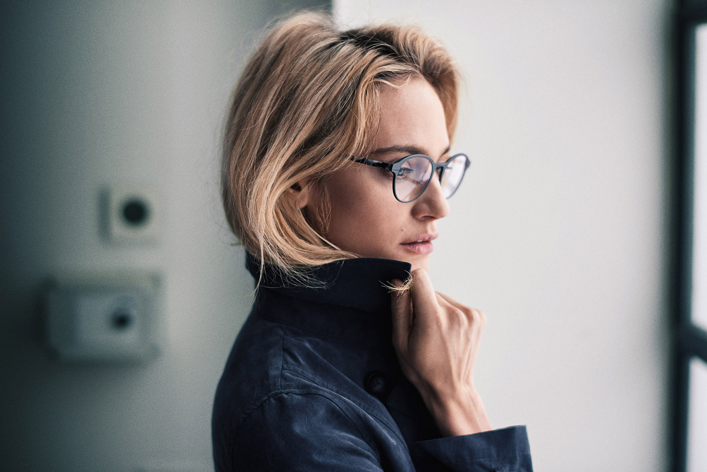 Woman wearing jacket and glasses